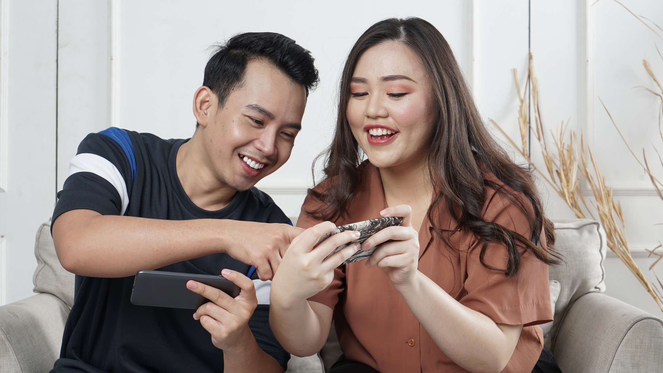 build trust with your brand. two people looking at a phone